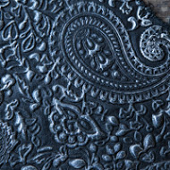 Silver on black embossed leather